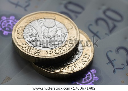 New one pound coins placed on top of each other. Close up photo with selective focus. Main focus is on the coins. Royalty-Free Stock Photo #1780671482