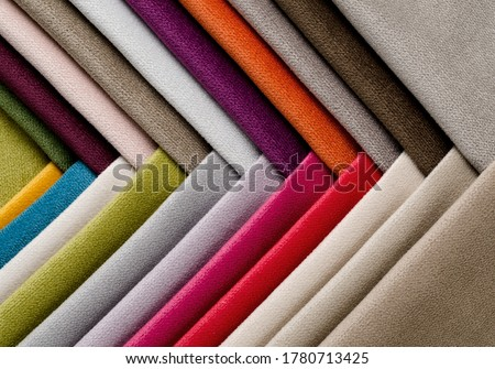 Bright collection of colorful velour textile samples. Fabric texture background Royalty-Free Stock Photo #1780713425