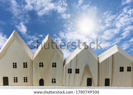 Front of the wooden model house on blue sky background. #1780749506