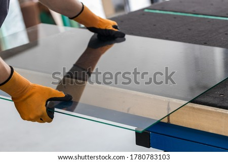 Glass factory, Glazier lifting that table glass Royalty-Free Stock Photo #1780783103