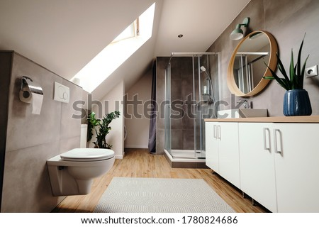 Large modern bathroom with luxury fittings. Modern bathroom interior. Bathroom with walk in shower. Stylish luxury urban restroom interior. Glass door shower and white cabinet with mirror. #1780824686