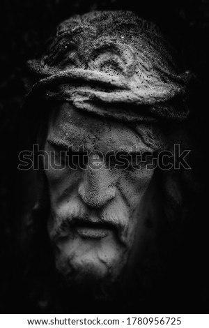 Antique statue of suffering of Jesus Christ crown of thorns. Black and white image.