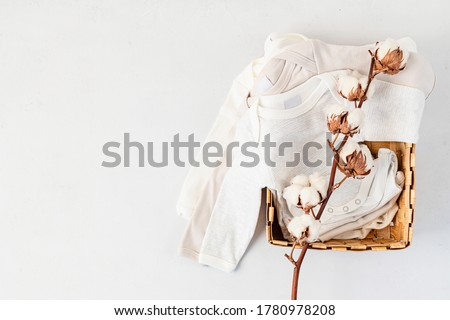 Cute newborn clothes. Organic cotton baby apparel mockup. Flat lay, top view Royalty-Free Stock Photo #1780978208