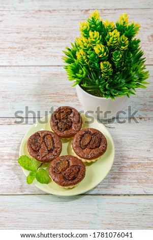 chocolate tart brownies with raisins on green dish - stock photo #1781076041