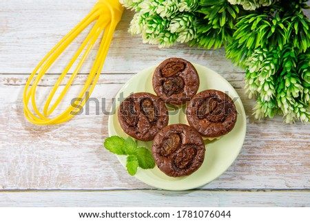 chocolate tart brownies with raisins on green dish - stock photo #1781076044