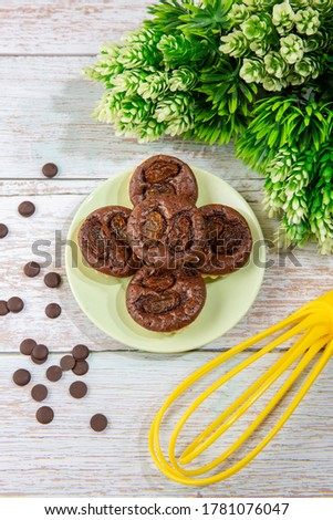 chocolate tart brownies with raisins on green dish - stock photo #1781076047