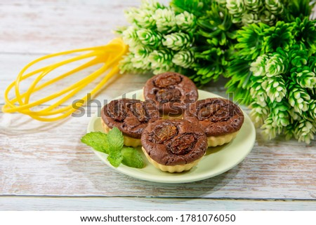 chocolate tart brownies with raisins on green dish - stock photo #1781076050