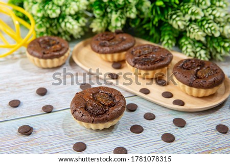 chocolate tart brownies with raisins on wooden dish - stock photo #1781078315