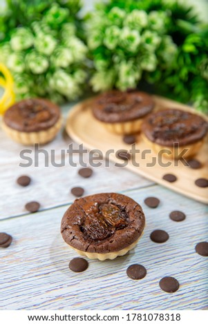 chocolate tart brownies with raisins on wooden dish - stock photo #1781078318