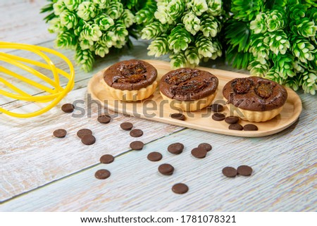 chocolate tart brownies with raisins on wooden dish - stock photo #1781078321