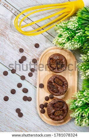 chocolate tart brownies with raisins on wooden dish - stock photo #1781078324