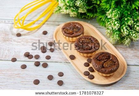 chocolate tart brownies with raisins on wooden dish - stock photo #1781078327