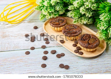 chocolate tart brownies with raisins on wooden dish - stock photo #1781078333