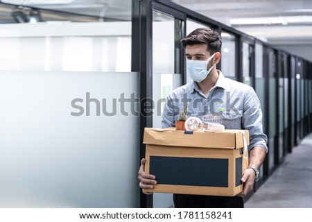 Virus Covid 19 crisis business due to outbreak of Coronavirus Disease 2019 or COVID-19, Unemployed man leaves of workplace, Dismissal from work. Job loss. Reduction of the company's staff.Unemployment #1781158241