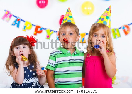 Group of adorable kids having fun at birthday party with birthday cake #178116395