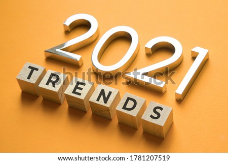 Wooden blocks with the word Trends and metal numbers 2021. Popular , relevant topics. New trends of fashion. Royalty-Free Stock Photo #1781207519
