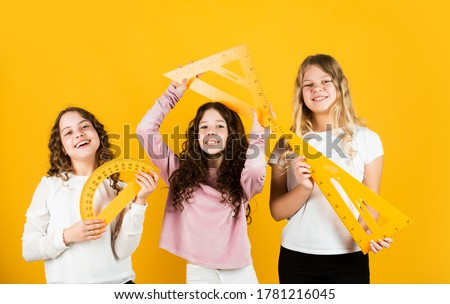 Inspired to work hard. three girls with protractor and triangle ruler. back to school. Geometry favorite subject. Education and school concept. School students learning geometry. math. exact sciences.