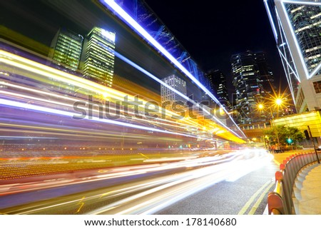 Fast moving car light in city #178140680