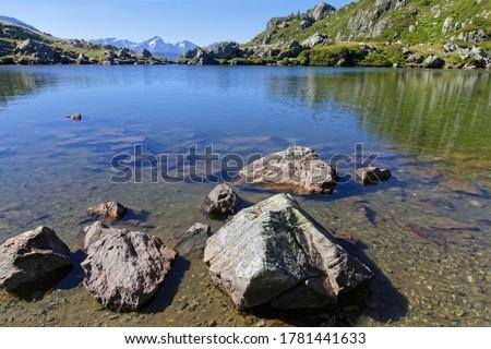 Shoreline of the mountain lake in Pas de la Coche Royalty-Free Stock Photo #1781441633