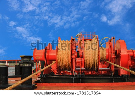 Mooring station Mooring winch, Mooring windlass with rope in drume  Royalty-Free Stock Photo #1781517854