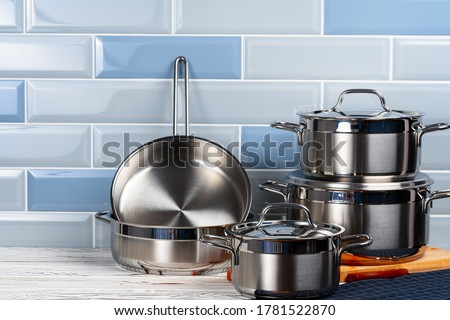 Set of aluminum cookware on kitchen counter #1781522870