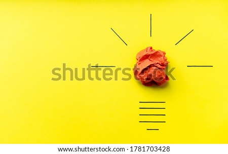 Light bulb over yellow background in vision and idea conceptual image. Conceptual image of creativity. Symbol of business strategy. Conceptual image of brainstorming, innovation and creativity Royalty-Free Stock Photo #1781703428