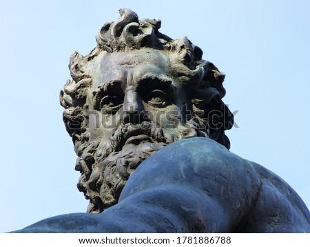 Neptune statue closeup. Fountain of Neptune located near Piazza Maggiore in Bologna. Italy.