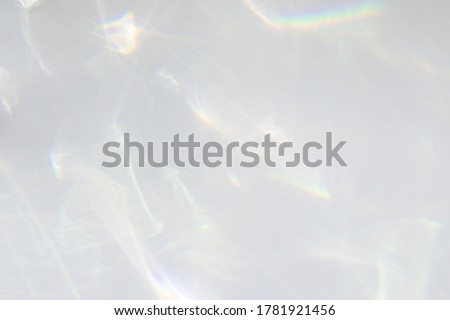 Water texture overlay effect for photo and mockups. Organic drop diagonal shadow and light caustic effect on a white wall. Shadows for natural light effects