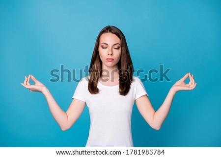 Photo serious focused girl train yoga exercise meditate show om gesture wear good look clothes isolated over blue color background
