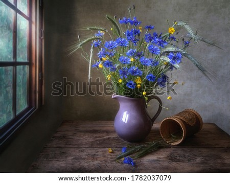 Rural still life with bouquet of cornflowers	 #1782037079