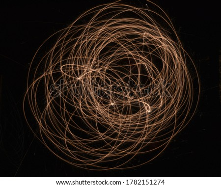 Circular Swirl Patterns and Light Trails created by a sparkler. Cool image for backgrounds! #1782151274