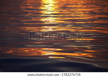 Mediterranean sea at sunrise. Golden sunlight reflecting in the water. Abstract natural pattern, texture, background, seascape, concept image, graphic resources Royalty-Free Stock Photo #1782276758