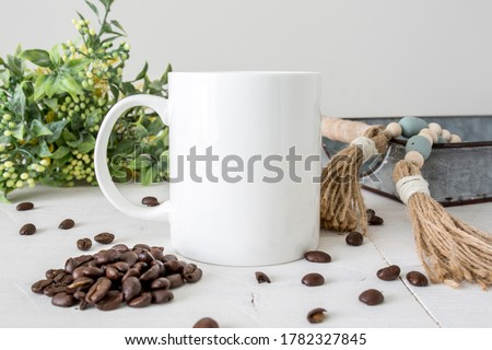 Blank white coffee mug on white background with coffee beans and rustic props, 11oz drinkware mockup