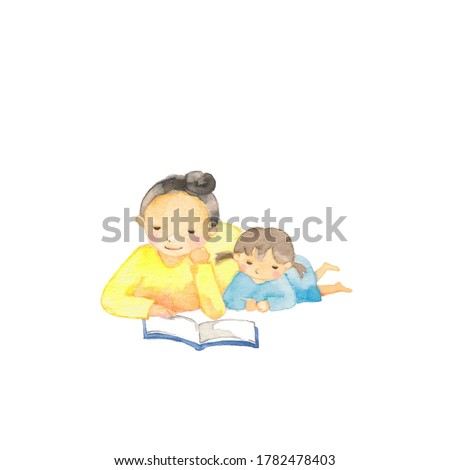 Mother and daughter lying down and reading a book