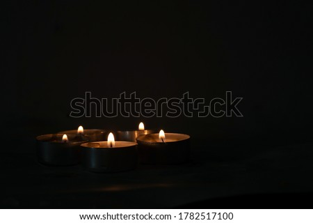 candles that are lit in the dark Royalty-Free Stock Photo #1782517100