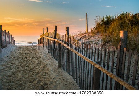 Sunrise glows at the Atlantic seashore at Marine St. in Beach Haven, New Jersey Royalty-Free Stock Photo #1782738350