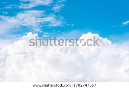 Cumulus clouds on blue sky, view from airplane window Royalty-Free Stock Photo #1782747557
