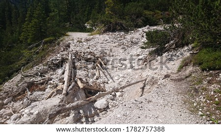 A destroyed path after a thunderstorm and a landslide. The picture was taken on the patz from the Grünwaldalm in the direction of the hochalm in the pragser valley
