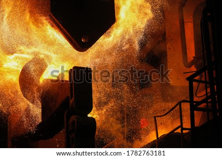 Steel production in electric furnaces. Sparks of molten steel. Electric arc furnace shop EAF. Metallurgical production, heavy industry, engineering, steelmaking. #1782763181