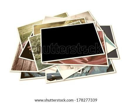 Stack of instant photographs isolated on white background. Photographs with space for your logo or text.