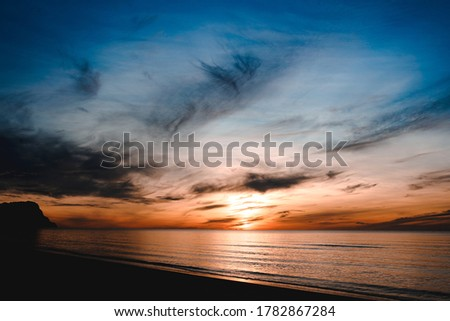 Beach sunrise with landscape background. Nature in twilight period which including of sunrise over the sea and the nice beach. Summer beach with blue water sky at the sunshine in Thailand.