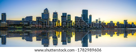 Panorama of Canary Wharf business district with water reflection at sunset #1782989606