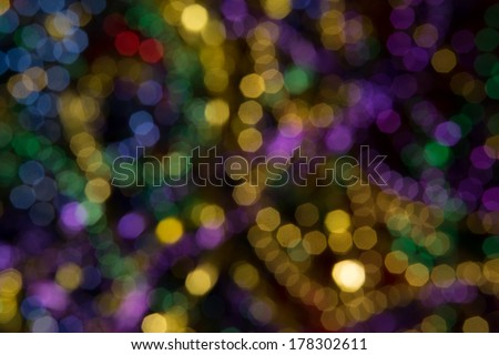 Abstract background of out of focus Mardi Gras Beads
