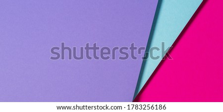 Abstract color papers geometry flat lay composition banner background with purple, blue and magenta color tones