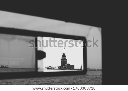 The Maiden's tower in Istanbul, Turkey. Photo taken from inside a cruise boat. This is a popular tourist attraction in the city.