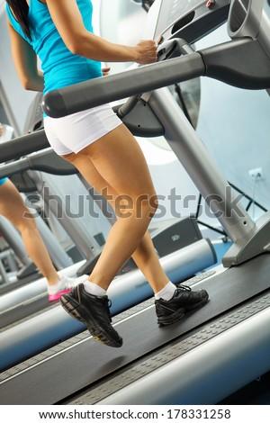 Image of female foot running on treadmill #178331258