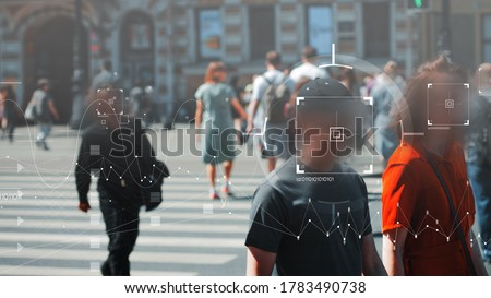 Face recognition and personal identification technologies in street surveillance cameras, law enforcement control. crowd of passers-by with graphic elements. Privacy and personal data protection, Royalty-Free Stock Photo #1783490738