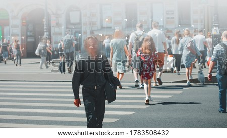 Face recognition and personal identification technologies in street surveillance cameras, law enforcement control. crowd of passers-by with graphic elements. Privacy and personal data protection, Royalty-Free Stock Photo #1783508432
