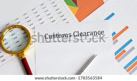 Paper with Customs Clearance on a table with chart