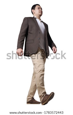 Full length portrait of Asian businessman wearing brown suit standing walking, side view low angle profile isolated on white #1783572443